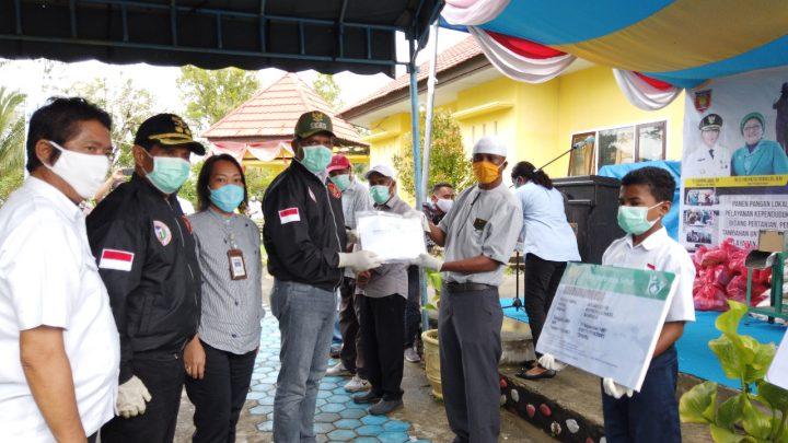 577 Masyarakat di Telutih-Malteng Terima KIS